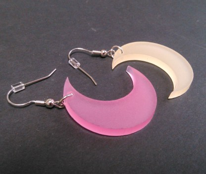 close up of pink and yellow moon earrings