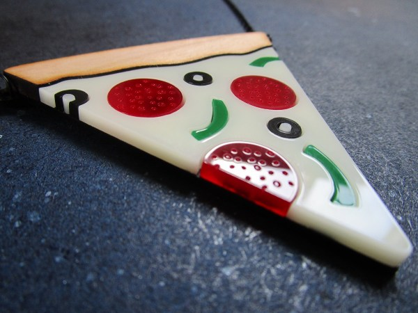 close up side view of laser cut Pizza Slice Statement Necklace