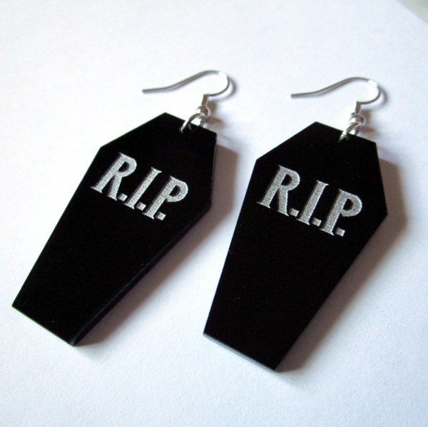 sideways coffin earrings with RIP in front with white background