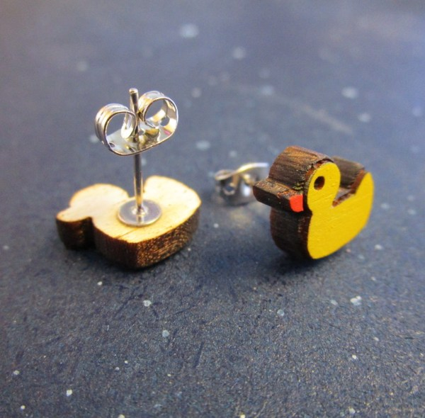 rubber duck stud earring upside down to show earring post and rubber duck earring sideways to show thickness