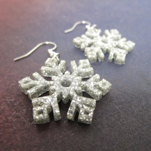 silver glitter snowflake earrings close up
