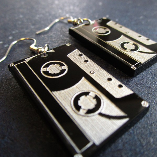 zoom in of lower corner of tape cassette dangle earrings