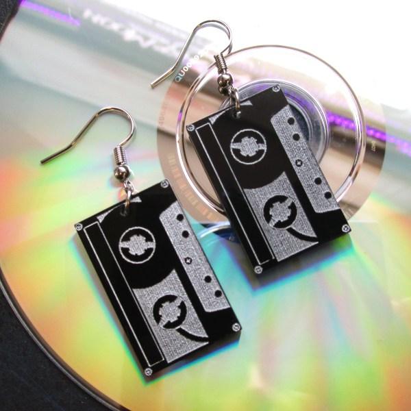 tape cassette earrings on top of cd