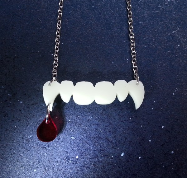 ivory vampire fang teeth with hanging blood drip pendant necklace