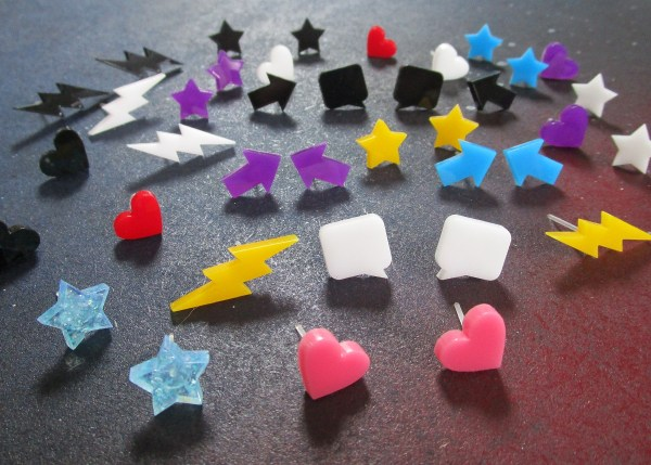 assortment of small colorful stud earrings in heart lightning star arrown bubble shapes
