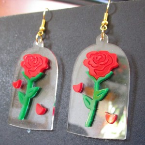 close sideways shot of beauty and beast rose earrings