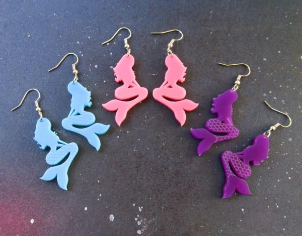 half circle configuration of mermaid dangle earrings