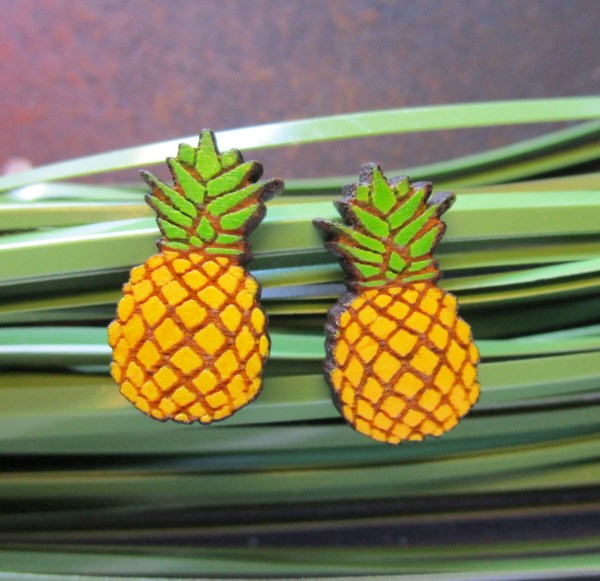 yellow Tiny Wooden Pineapple Stud Earrings on grass strands