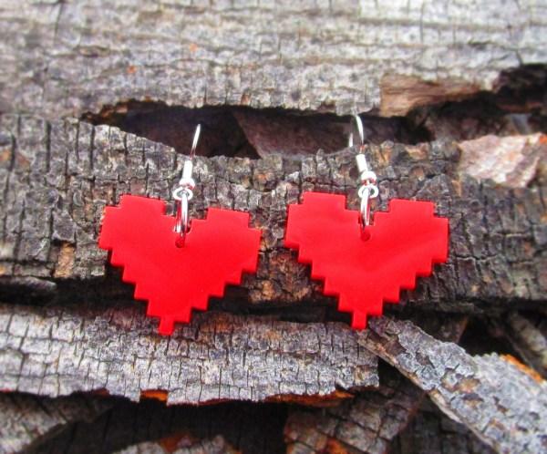 red 8 bit pixel heart dangle earrings on wood background