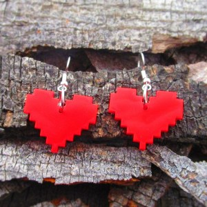 red 8 bit pixel heart dangle earrings on wood background