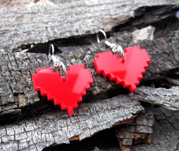 close up of red life heart container cosplay earrings