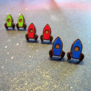 staggered collection of pairs of rockethip earrings in blue red and green