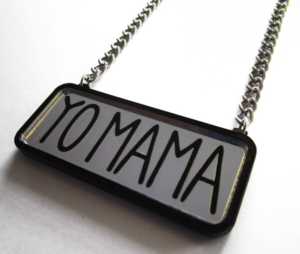 yo mama text pendant on silver chain with white background facing sideways