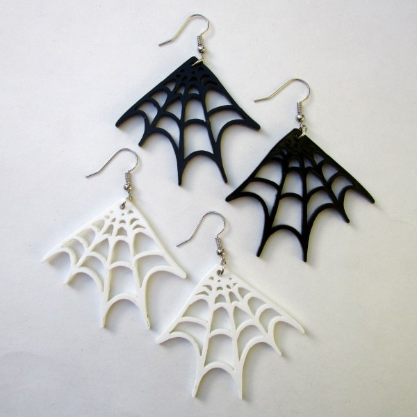 spider web earrings in black and white on white background