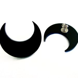 black crescent moon shaped earrings showing earring post backing