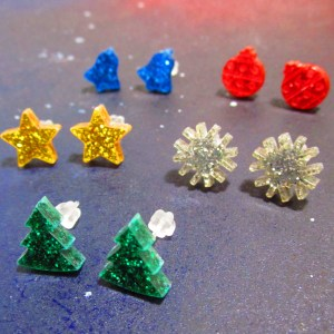 side view of glitter christmas earring collection
