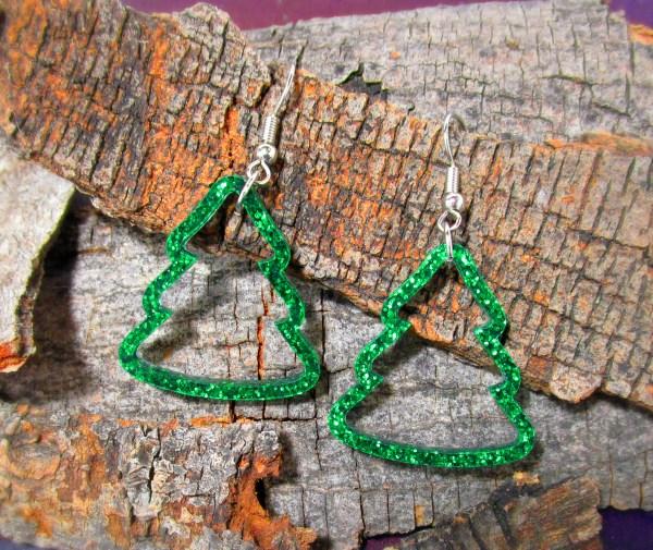 Glitter Green Christmas Tree Outline earrings on bark background