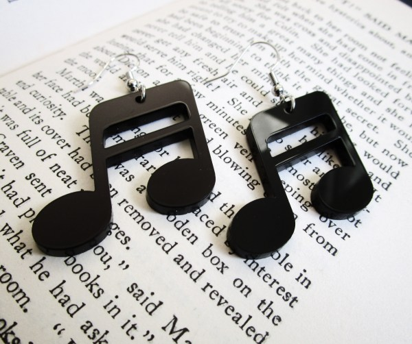 music note earrings on book page