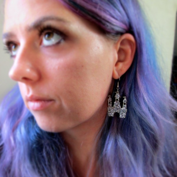 lady with purple hair wearing Silver Glitter Magical Princess Castle Earring in ear