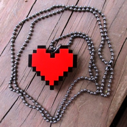 8 bit heart necklace on wood