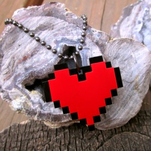 glamour shot of t Pixel Red Heart Necklace on cool rock