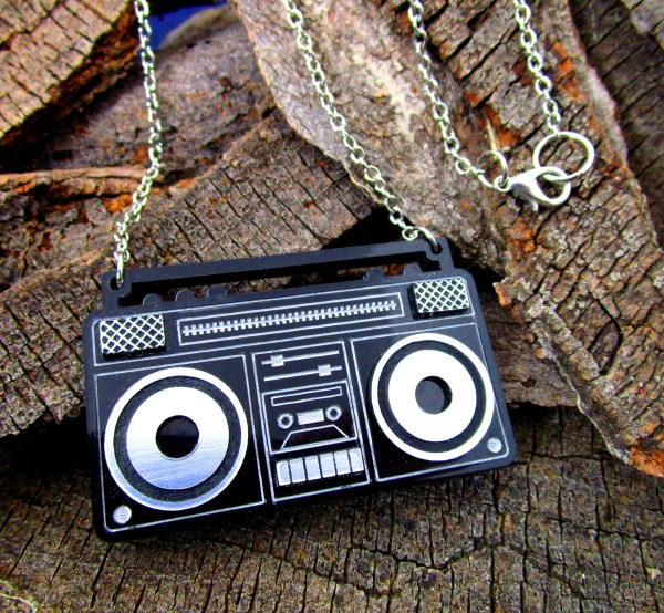 left view of boom box stereo pendant statement necklace on wood