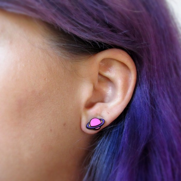 ear with pink and purple ringed planet stud post earrings