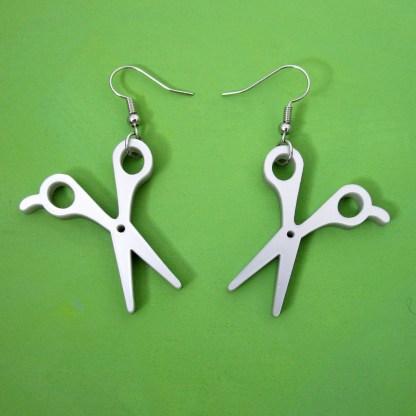 scissor earrings with green background