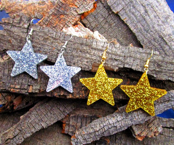 glitter gold and silver big star dangle earring on wood in a row