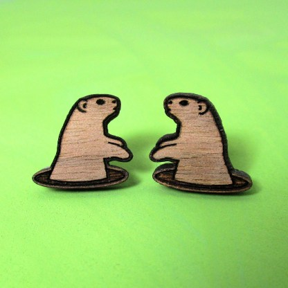 woodchuck stud earrings made of wood with green background