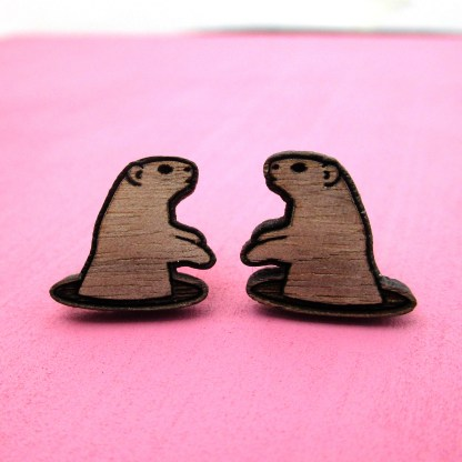 wooden rodent woodchuck groundhog stud earrings with pink background