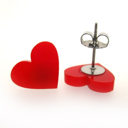 close up of red heart earrings