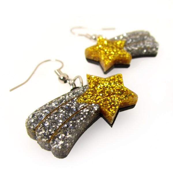 Up close view of glitter shooting star earrings