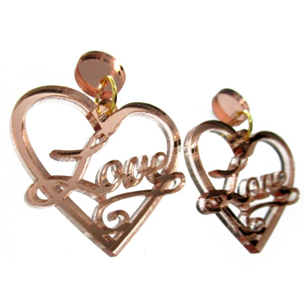 side view of love heart earrings in rose gold color