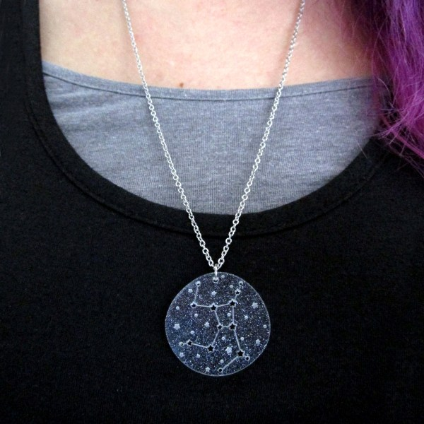 wearing a star chart zodiac sign pendant necklace