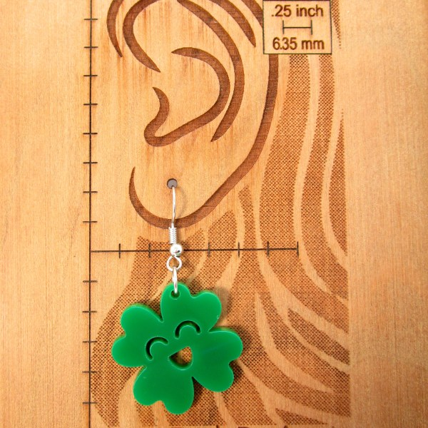 ear scale with green clover earring to show size