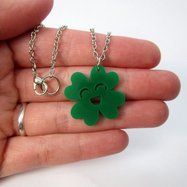 hand holding happy kawaii clover st patricks day pendant necklace to show size