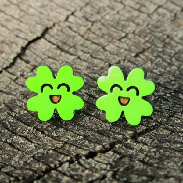 kawaii clover stud earrings on wood background