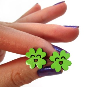 hand holding 4 leaf clover green kawaii stud earrings