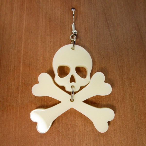 jolly roger dangle earrings pirate earrings with wood background