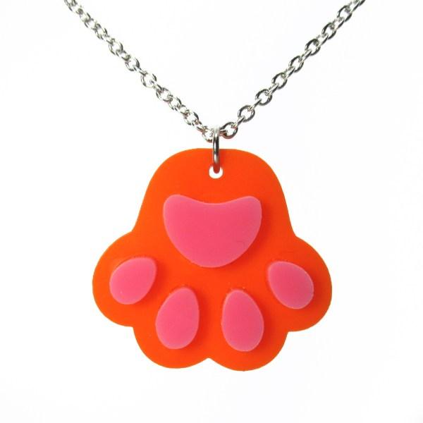 orange paw print pendant necklace on white background