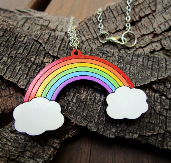 rainbow and clouds pendant on wood background