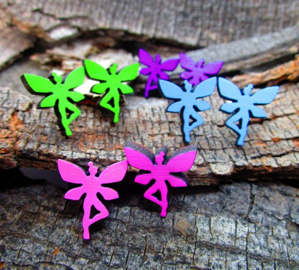 collection of colorful faerie fairy pixie stud earring on wood background