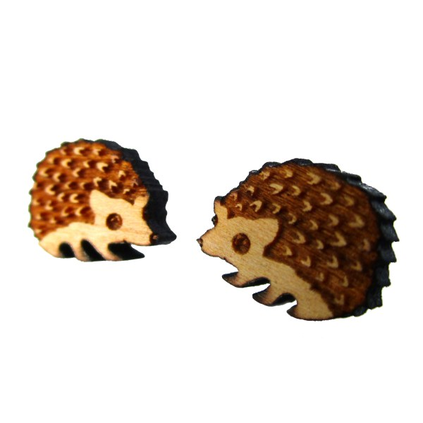 sideways view of cherry wood hedgehog laser cut earrings