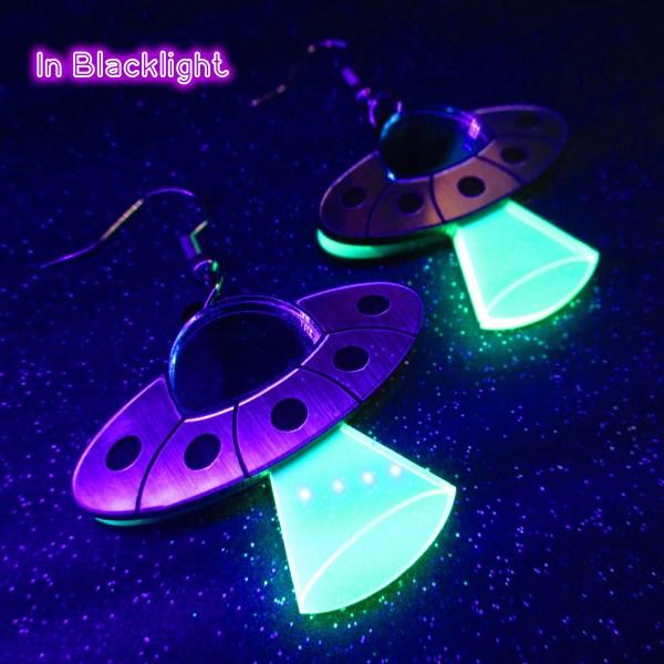 udo alien spaceship earrings under black light to show glow