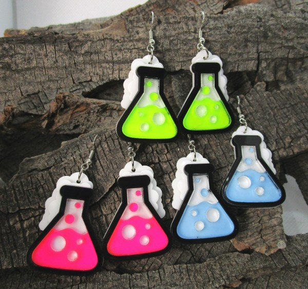 science beaker scientist experiment dangle earrings is 3 colors on wood background
