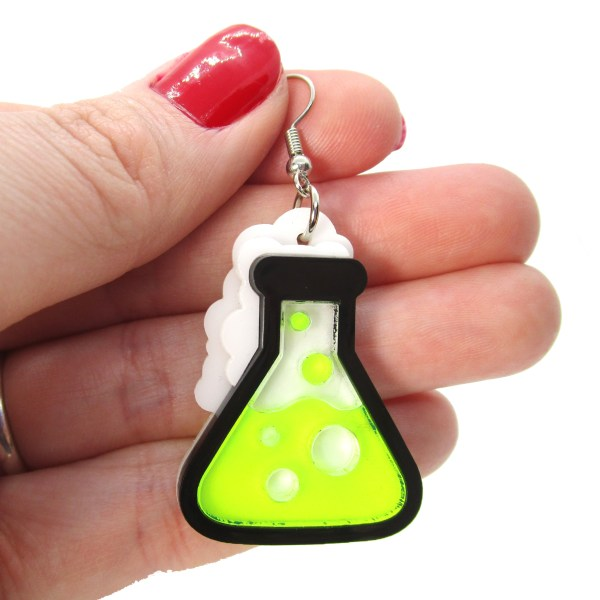 neon green beaker nerd earring in hand to show size