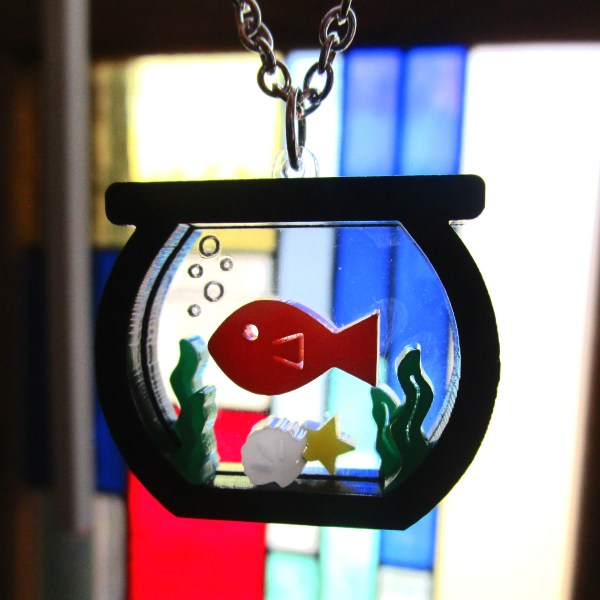 acrylic laser cut gold fish in fishbowl pendant close up to show detail