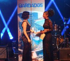 Melissa Megan accepting her Honey Jam Barbados prize from Founder Ebonnie Rowe courtesy of Barbados Tourism Marketing Inc.