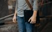 A guy holding a chromebook